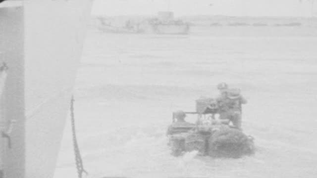237 combat engineers landing on utah beach / jeep and trucks enter the water / approaching the beach / dday utah beach on june 06 1944 in france - d day stock videos & royalty-free footage
