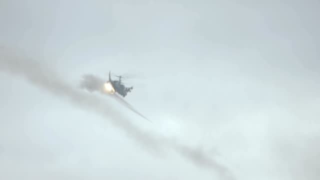 Combat helicopter firing unguided rockets