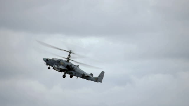 Combat helicopter flying in the sky