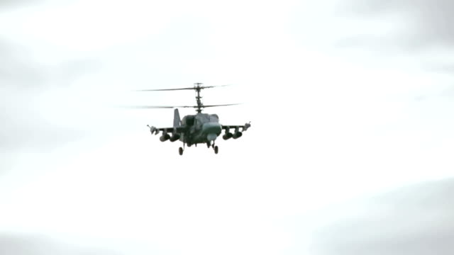 combat helicopter flying in the sky - military helicopter stock videos & royalty-free footage