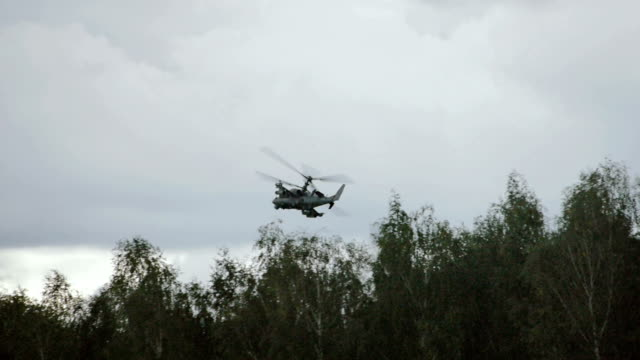 Combat helicopter flying over the forest
