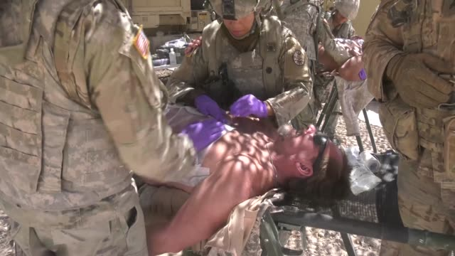 a combat medic team with the idaho army national guard practice administering immediate medical aid to acting casualties for response training... - medical dressing stock videos & royalty-free footage
