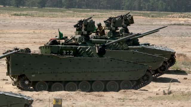 combat vehicle 90 take part in the nato noble jump military exercises following a live fire demonstration on june 12, 2019 in zagan, poland. the... - nato stock-videos und b-roll-filmmaterial