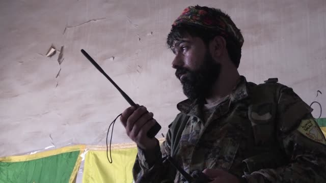 combatants from the syrian democratic forces a us backed arab kurdish alliance advanced on tuesday in raqa's old city as they battled jihadists of... - syrian democratic forces stock videos & royalty-free footage