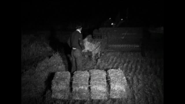 combine harvester at night in a field with straw baler; 1963 - 1963 stock videos & royalty-free footage