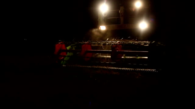 combine harvester at night - agricultural machinery stock videos & royalty-free footage