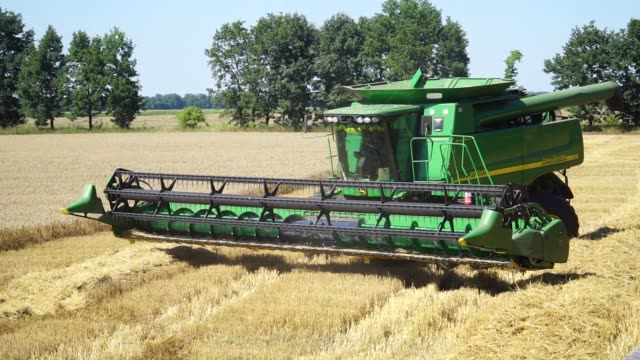 Combine harvesters operated by Agrotrade Group harvest a field of wheat in Chernihiv Ukraine on Thursday Aug 10 2017