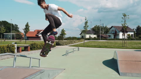 ms combined clips young man skateboarding in sunny skate park - sporting term stock videos & royalty-free footage