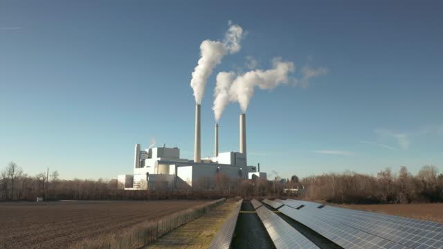 as combined heat and power station in unterföhring near munich, germany - kraftwerk stock-videos und b-roll-filmmaterial