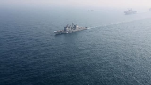 combined naval forces from the united states navy expeditionary strike group 7 and republic of korea navy sail in formation during exersise ssang...