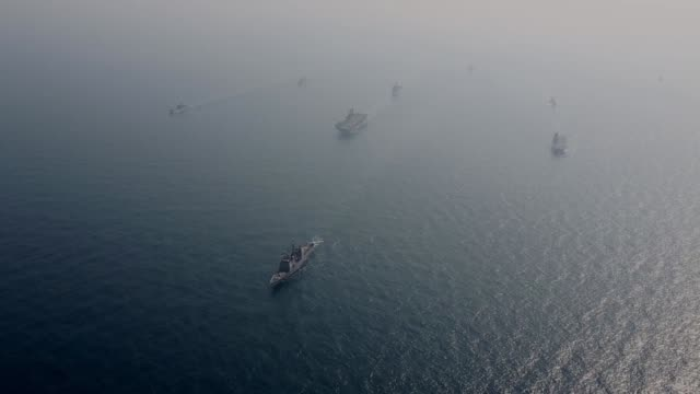 combined naval forces from the united states navy expeditionary strike group 7 and republic of korea navy sail in formation during exersise ssang... - 海軍点の映像素材/bロール