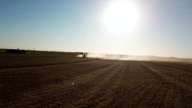combines at heading into the sun 180 turn. - soybean stock videos and b-roll footage