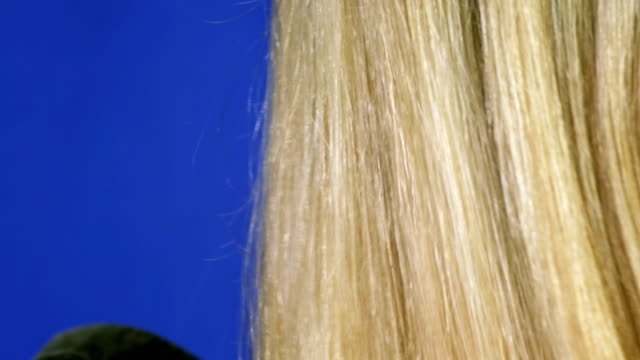 HD: Combing Blonde Woman Hair