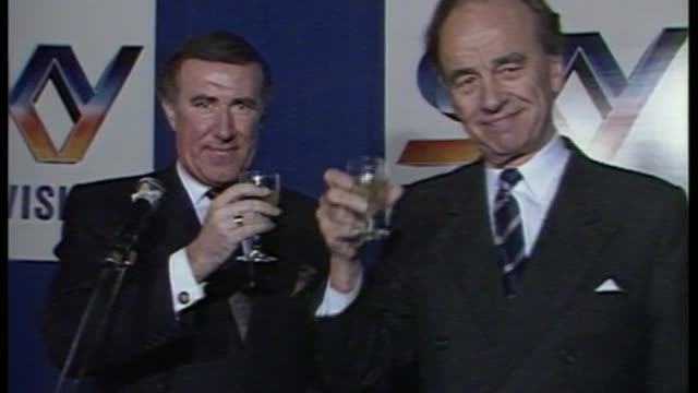 comcast bids to take over sky; as050289011 / england: london: isleworth: int rupert murdoch and andrew neil at sky television launch with champagne... - andrew neil stock videos & royalty-free footage