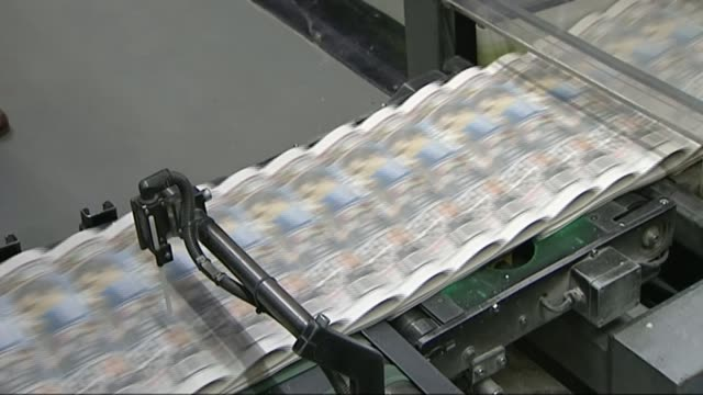 comcast bids to take over sky r25021201 / broxbourne int various shots of unidentified tabloid newspapers along on conveyor belt at printing press... - rupert murdoch stock videos and b-roll footage