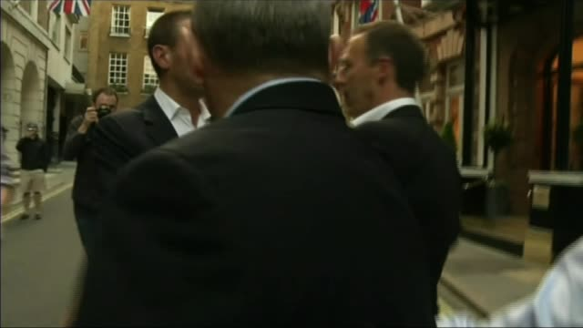 comcast bids to take over sky t12071103 / photography*** various of rupert murdoch and james murdochleaving hotel on foot as surrounded by press - rupert murdoch stock videos and b-roll footage