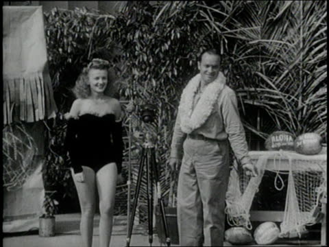comedian bob hope and a woman in a swimsuit perform in a uso show. - bob hope komiker stock-videos und b-roll-filmmaterial