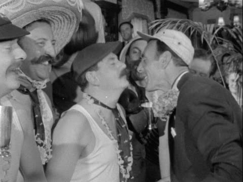 vídeos y material grabado en eventos de stock de comedian, eric sykes presents a medal to the winner of a spaghetti-eating contest during the soho fair celebrations in central london. - moustache