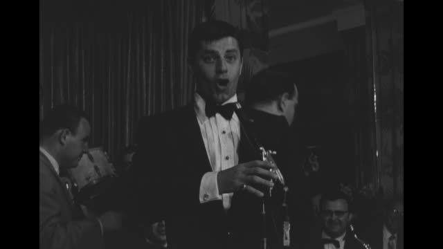 comedian jerry lewis sings onstage during an appearance at brown's hotel in loch sheldrake, ny, as conductor waves baton behind him - comedian stock videos & royalty-free footage