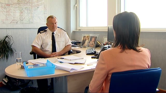 comedian jimmy tarbuck interviewed over sex abuse claims chief constable andy trotter sitting with reporter and interview sot - ジミー ターバック点の映像素材/bロール