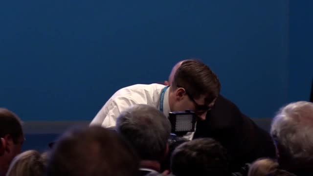 comedian lee nelson gives theresa may a p45 form at the conservative party conference in manchester - simon brodkin comedian stock videos and b-roll footage
