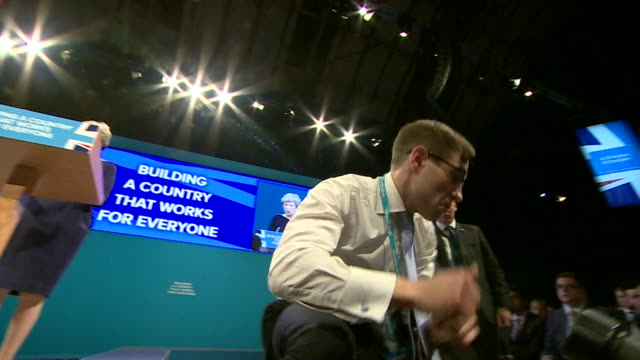 comedian simon brodkin handing theresa may a p45 at the conservative party conference - simon brodkin comedian stock videos and b-roll footage