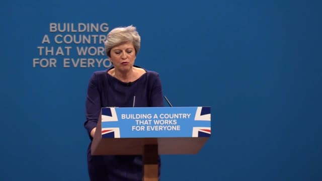 comedian simon brodkin interrupts theresa may's speech to hand her a p45 form at the conservative party conference in manchester - simon brodkin comedian stock videos and b-roll footage