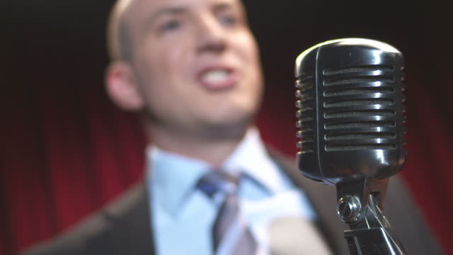 hd: comedian talking into microphone - comedian stock videos & royalty-free footage