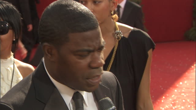 Comedian Tracy Morgan on crowded red carpet outside Nokia Theatre talking to press