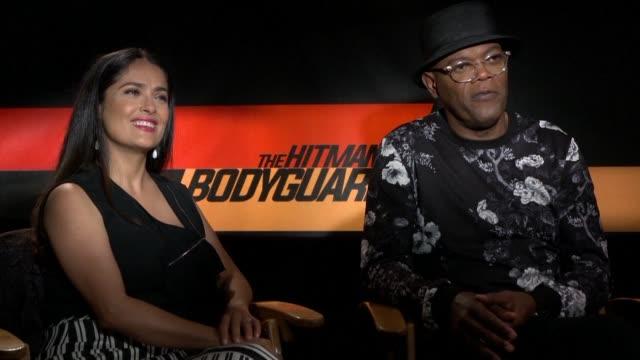 comedy meets action in the hitman's bodyguard starring salma hayek samuel l. jackson and ryan reynolds - salma hayek stock videos & royalty-free footage