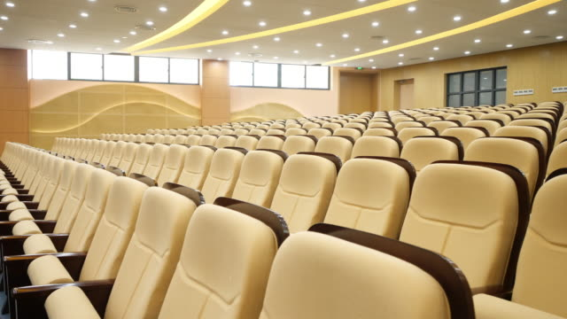 comfortable chairs in modern luxury conference hall - lecture hall stock videos & royalty-free footage