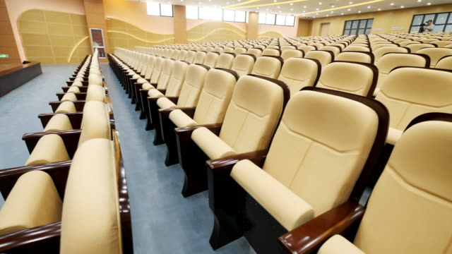 comfortable chairs in modern luxury conference hall - chairs in a row stock videos & royalty-free footage