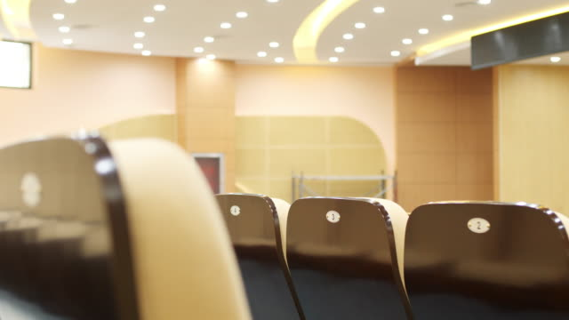 comfortable chairs in modern luxury conference hall - auditorium stock videos & royalty-free footage