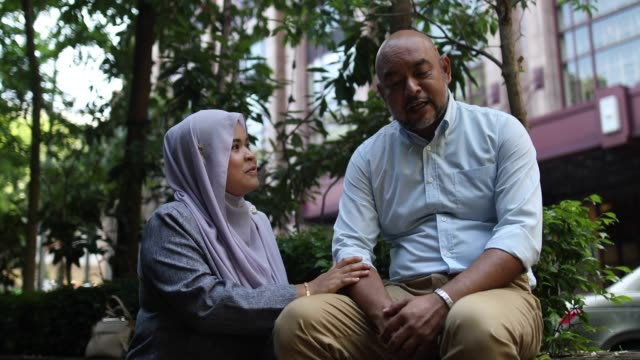 comforting her father in days of sorrow - malay family stock videos and b-roll footage