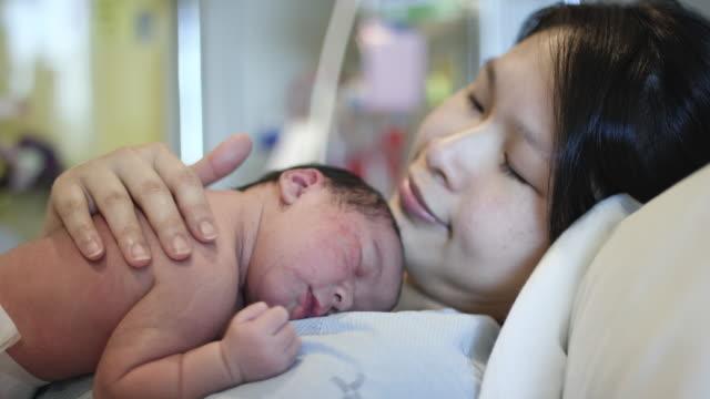 Comforting Her Sleeping Newborn