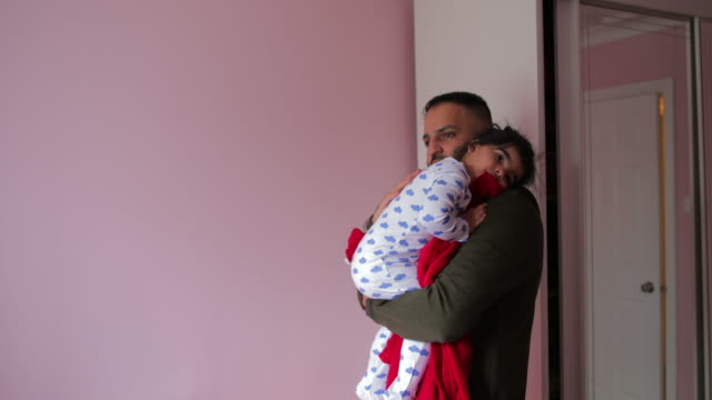 comforting his baby girl - babygro stock videos & royalty-free footage