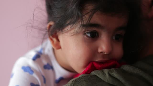 comforting his baby girl - tutina video stock e b–roll