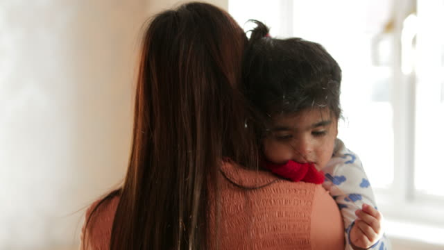 comforting hugs from mother - tutina video stock e b–roll