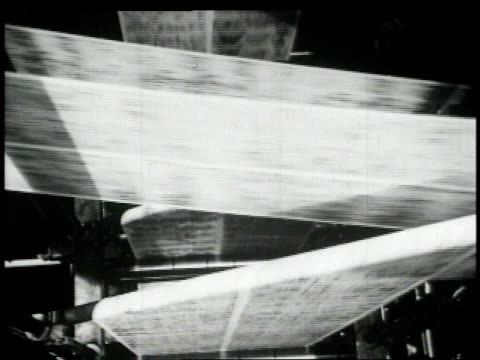 1948 montage comic moving through printing presses / united states - 1948 stock-videos und b-roll-filmmaterial