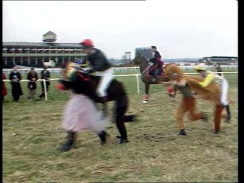 vídeos y material grabado en eventos de stock de comic relief day 1989; newbury: army 'pantomime horse' race underway r-l as along & 'horses' wearing red noses cms army officer astride horse as... - red nose day