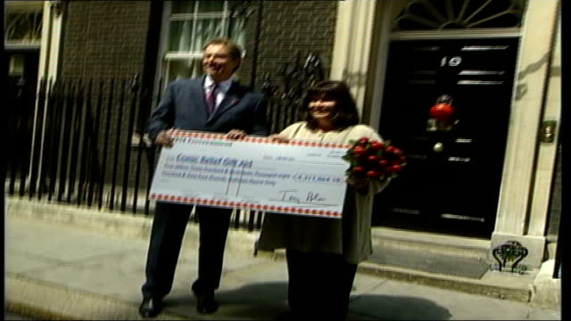 gift aid cheque presented at 10 downing street itn england london 10 downing street up red nose on 10 downing street front door / lms tony blair and... - dawn french stock videos & royalty-free footage