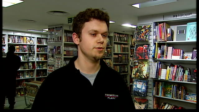 fans enraged as spiderman becomes a bachelor again; england: london: int spider-man comics being put onto shelf at forbidden planet store by adam... - 独身男性点の映像素材/bロール