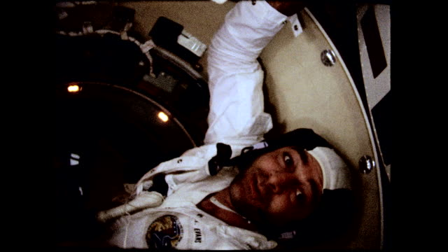 / command module pilot ronald evans and commander eugene cernan floating in command module. apollo 17 astronauts in space capsule on december 11,... - 1972 stock videos & royalty-free footage