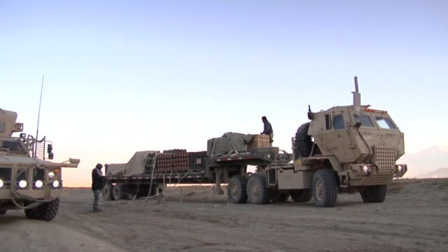 A Command Security Team in Afghanistan escort demolition technicians to a range outside of Bagram Airfield to destroy unserviceable munitions