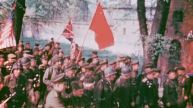 ts command staff from russia the united kingdom and the united states marching with their flags into village / torgau germany - former ussr flag stock videos & royalty-free footage