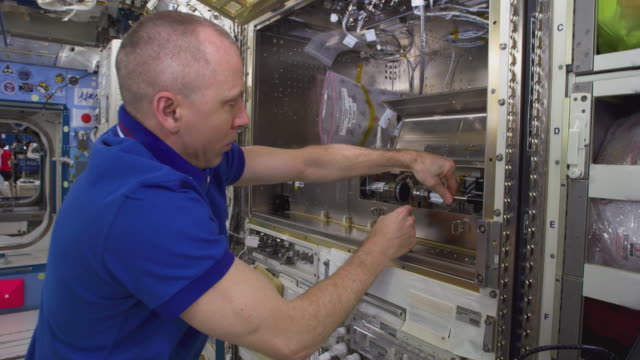 commander andrew feustel works inside the spaceship the mission of expedition 56 began on 1 june 2018 upon the departure of soyuz ms07 it ended on... - astronaut stock-videos und b-roll-filmmaterial