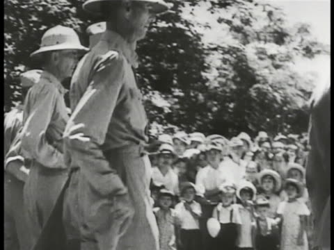 commander jonathan wainwright iv making surrender announcement: vs wainwright walking w/ other officers, followed by many soldiers. soldiers looking... - pacific war video stock e b–roll