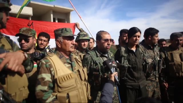 commander of the peshmerga unit ahmed gerdi, ypg commander dijwar xebat and ypj commander hebun derik speak to the media over the latest developments... - クルド人点の映像素材/bロール