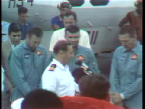commander philip eldredge jerauld, chaplain of the uss iwo jima, says a brief prayer at the astronauts' safe arrival. - south pacific ocean stock videos & royalty-free footage