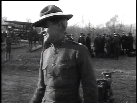 commander smiling at camera and gesturing to someone / recruits dressed in civilian clothes standing in group while commander calls roll - chillicothe stock videos & royalty-free footage